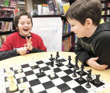 Two students playing chess.