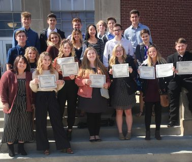MSD of Martinsville, Martinsville Schools, Martinsville Indiana group of students standing and smiling at camera. Some students holding their awards.