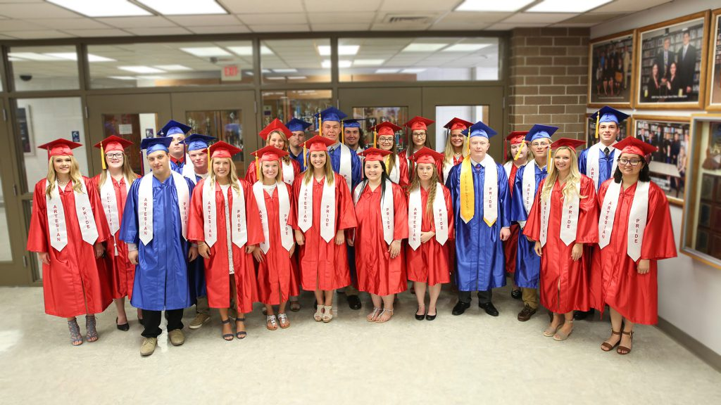 Group of students standing. Wearing graduation gowns. PRIDE program, Martinsville schools, MSD of Martinsville, Indiana